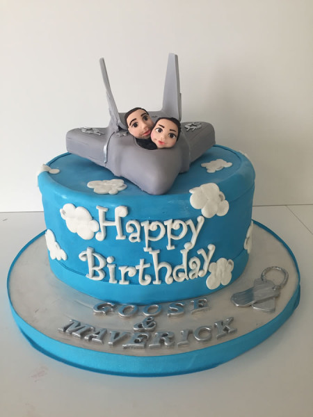 Top Gun theme birthday cake with airplane