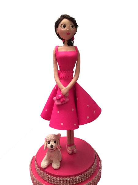 Lady in Pink with dog cake topper